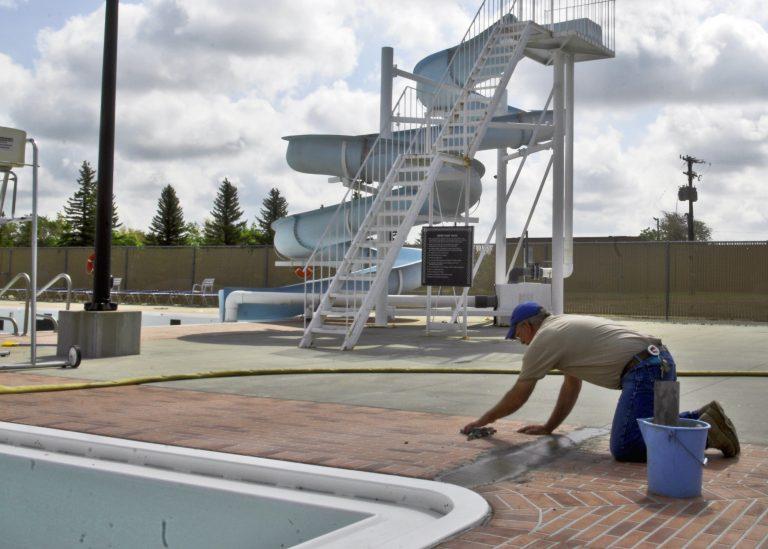 man-installing-commercial-pool-deck-coating