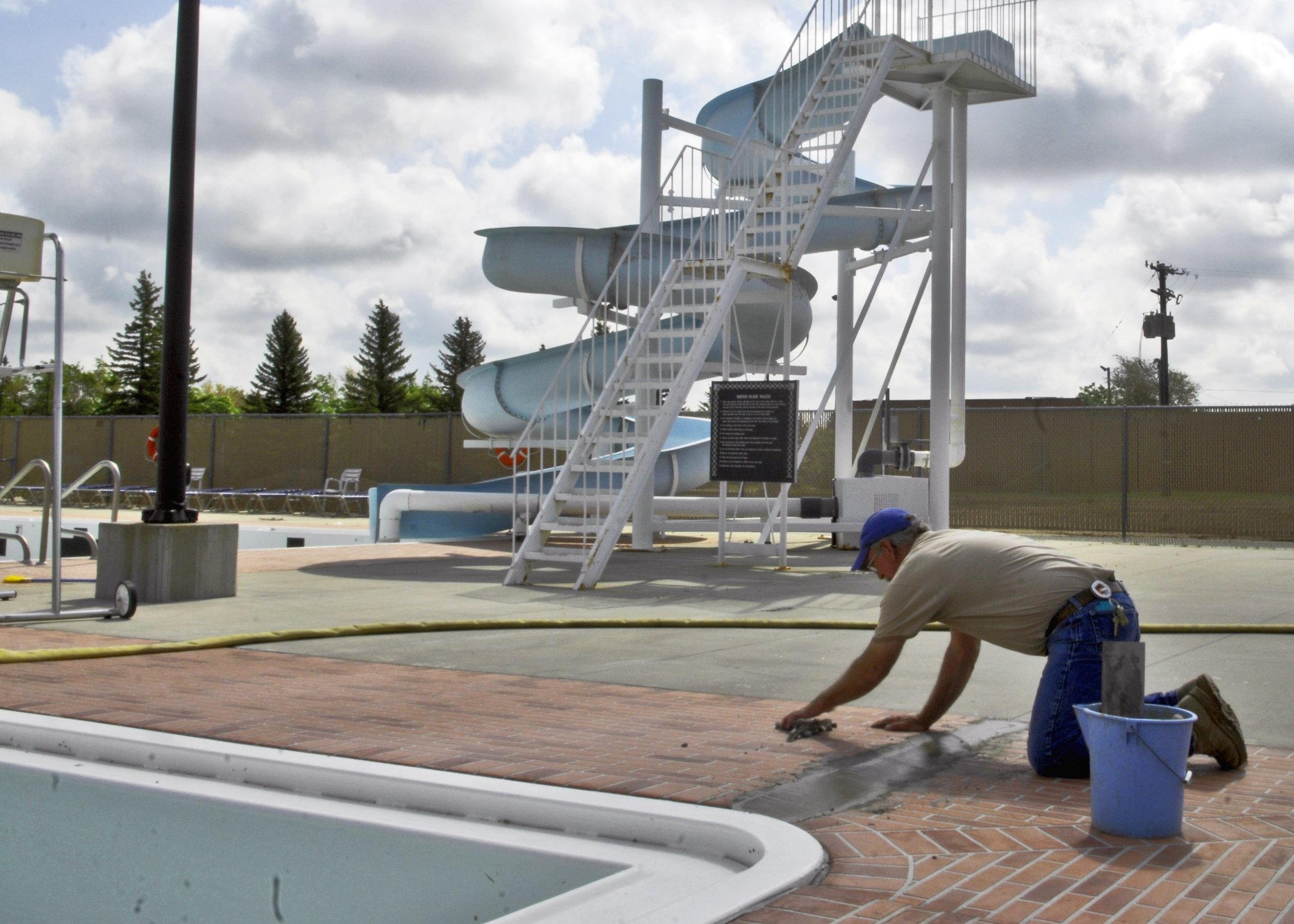 man-installing-commercial-pool-deck-coating