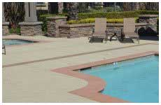 white and pink pool deck with two brown sunbathing chairs
