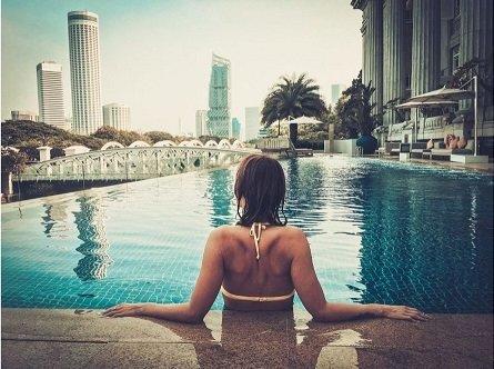 woman enjoying the luxurious high rise pool