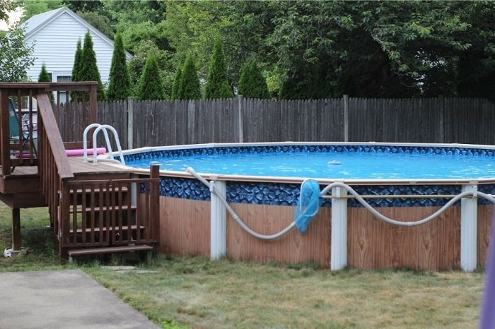 Above ground pool in the backyard
