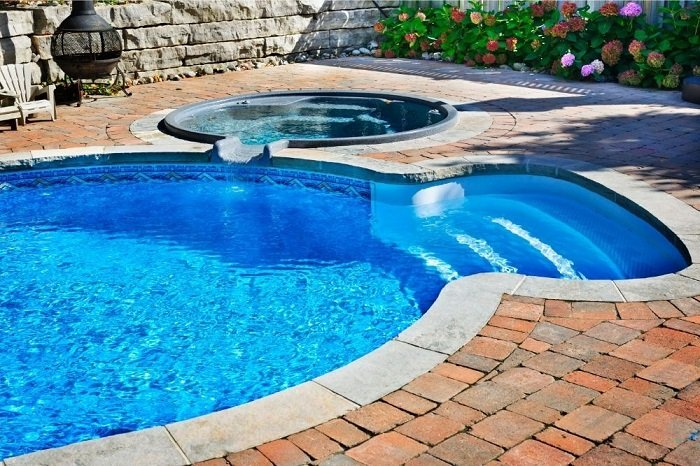 Inground pool with hot tub